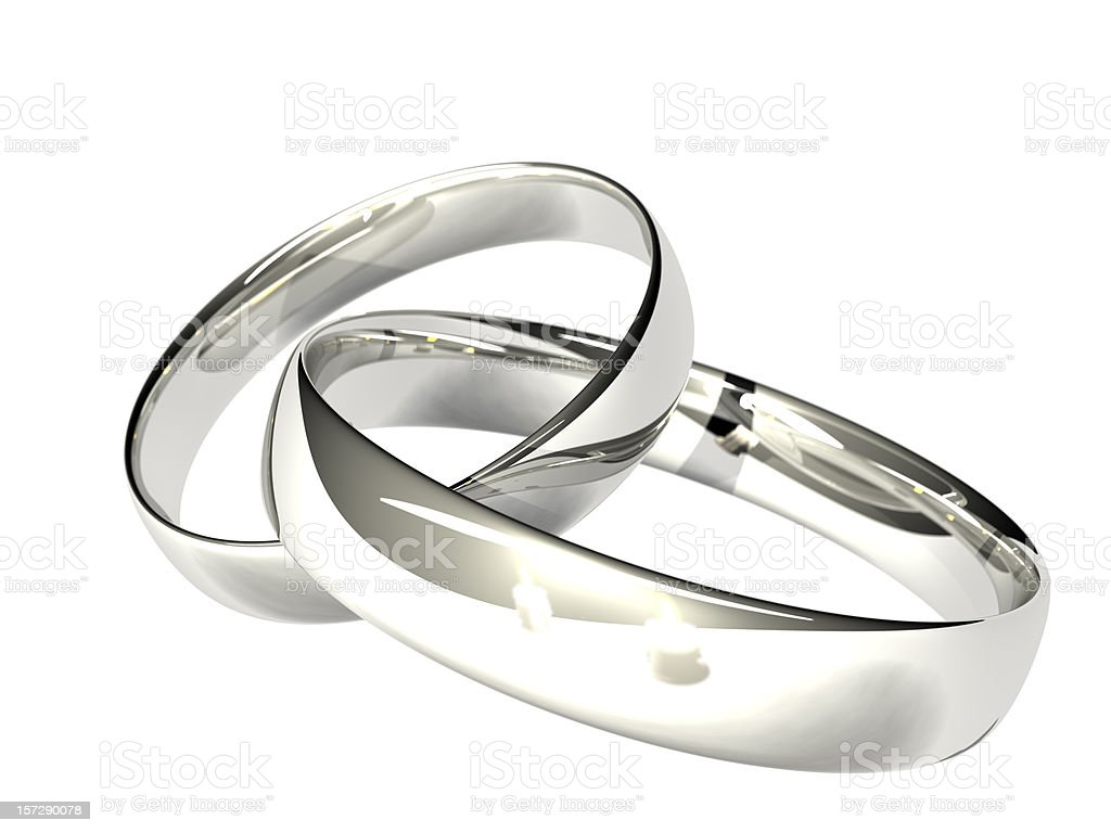 Two Platinum or Silver Wedding Rings - Reflected Candles stock photo