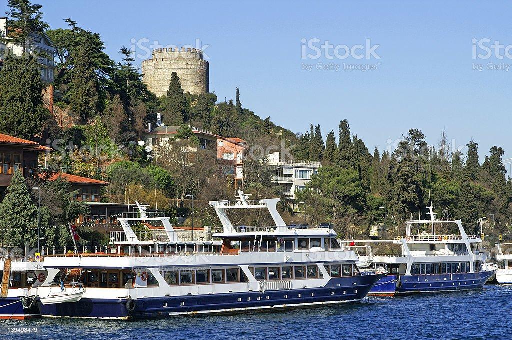 Two pleasure boats near Rumeli Fortress, Istanbul, Turkey stock photo