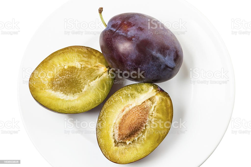 Two plums on a white plate royalty-free stock photo