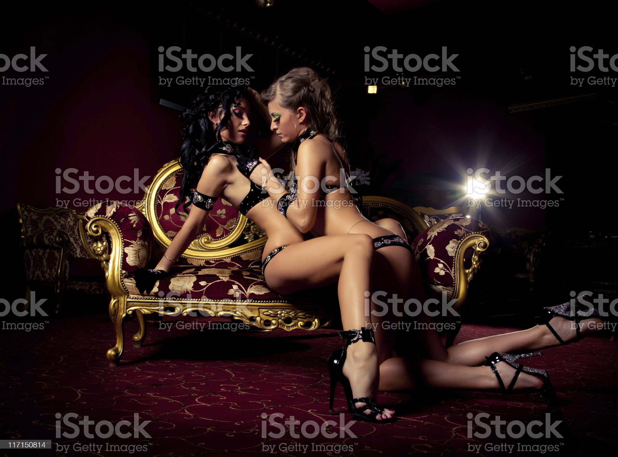 Two pole dancers at a nightclub royalty-free stock photo