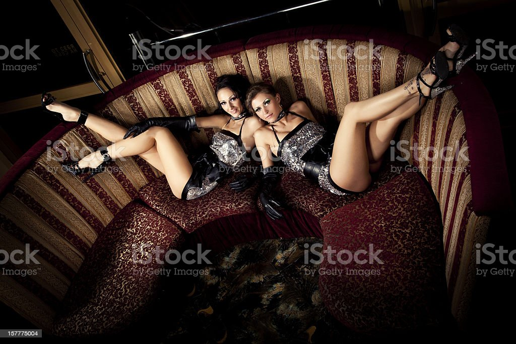 Two pole dancers at nightclub stock photo