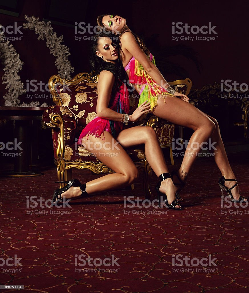 Two pole dancers at nightclub royalty-free stock photo