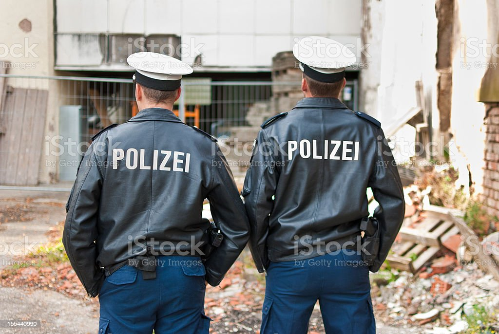 Two police officers are showing their back stock photo