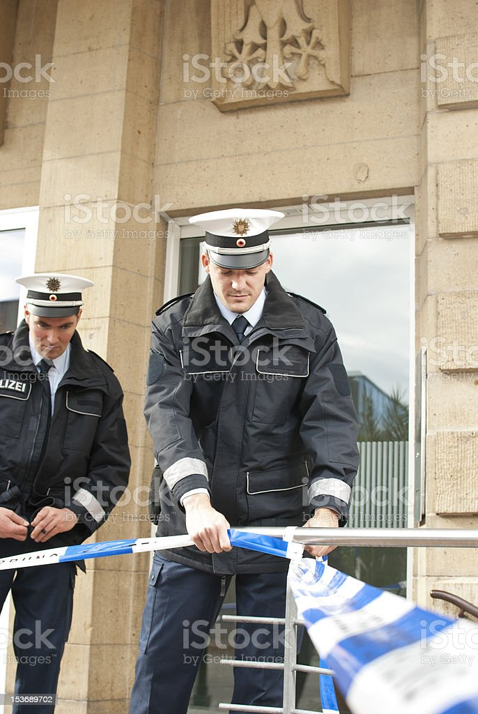 two police officers cordon off an area stock photo