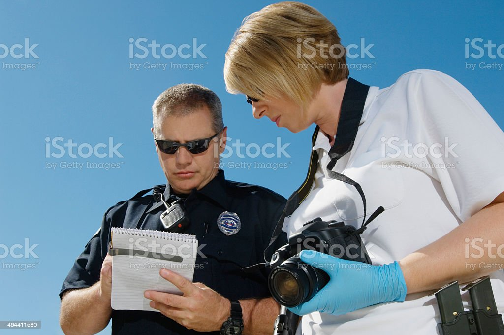 Two Police Officers Discussing Report stock photo