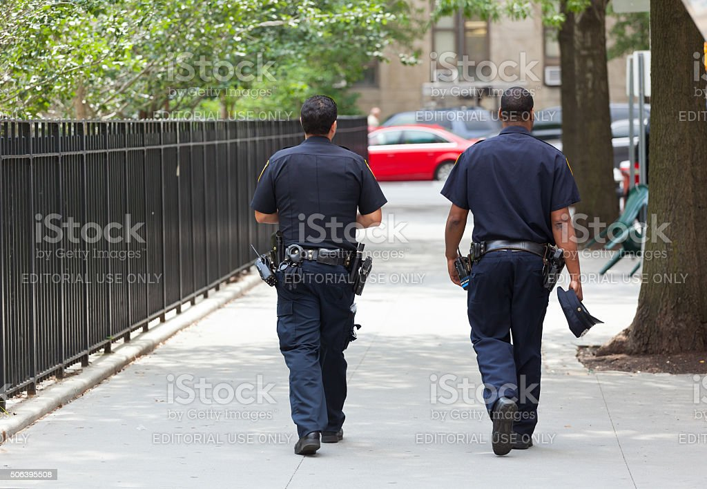 Two police officers from the back in Manhattan. stock photo
