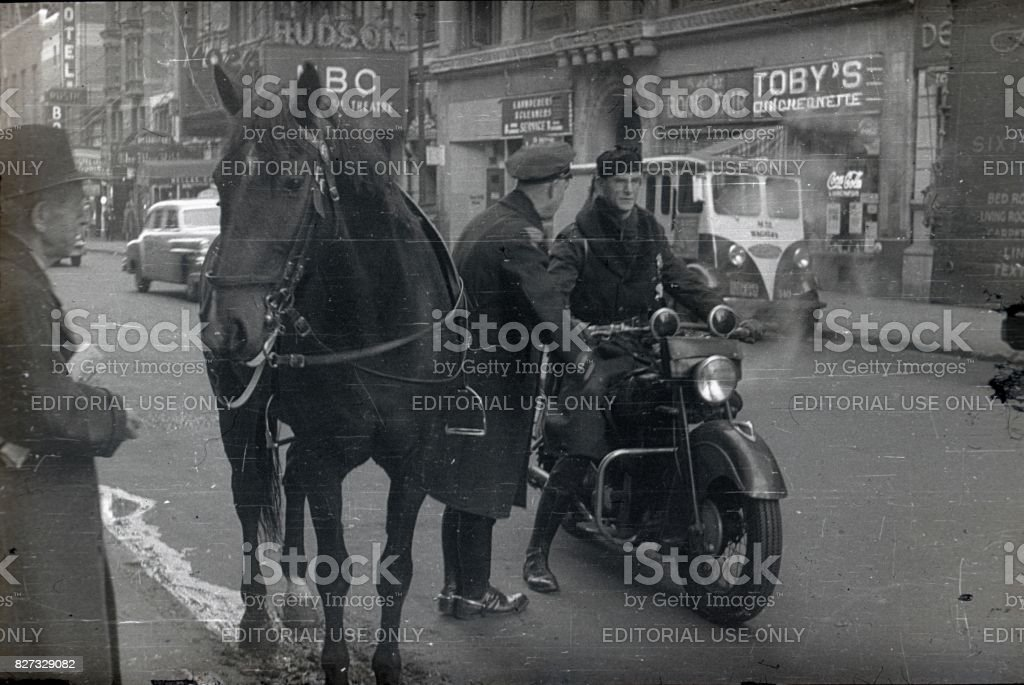 Two police officers  on a street in New York City, 1951 stock photo