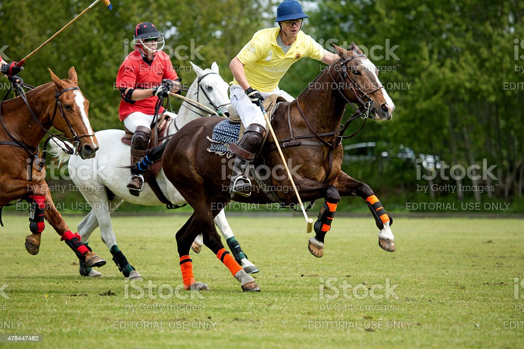 Two polo teams challenging for the ball stock photo