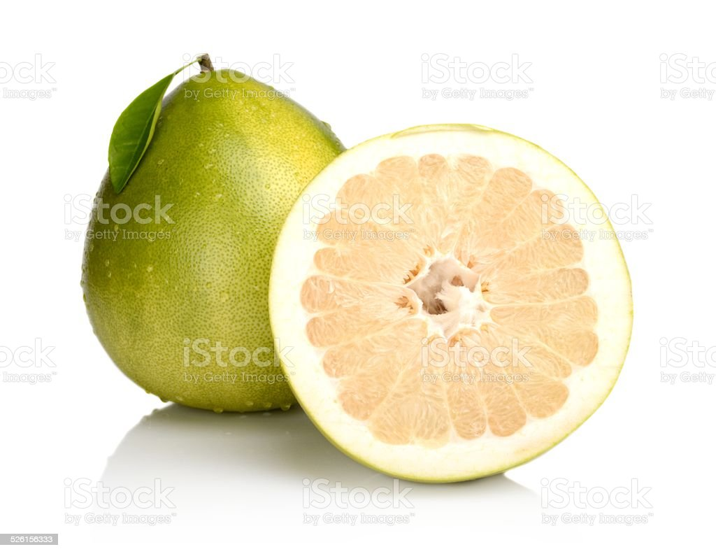 Two pomelos,half with drops water,leaf isolated on white stock photo