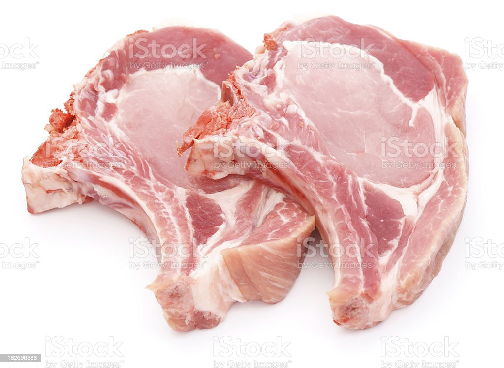 Two pork chops isolated on white stock photo