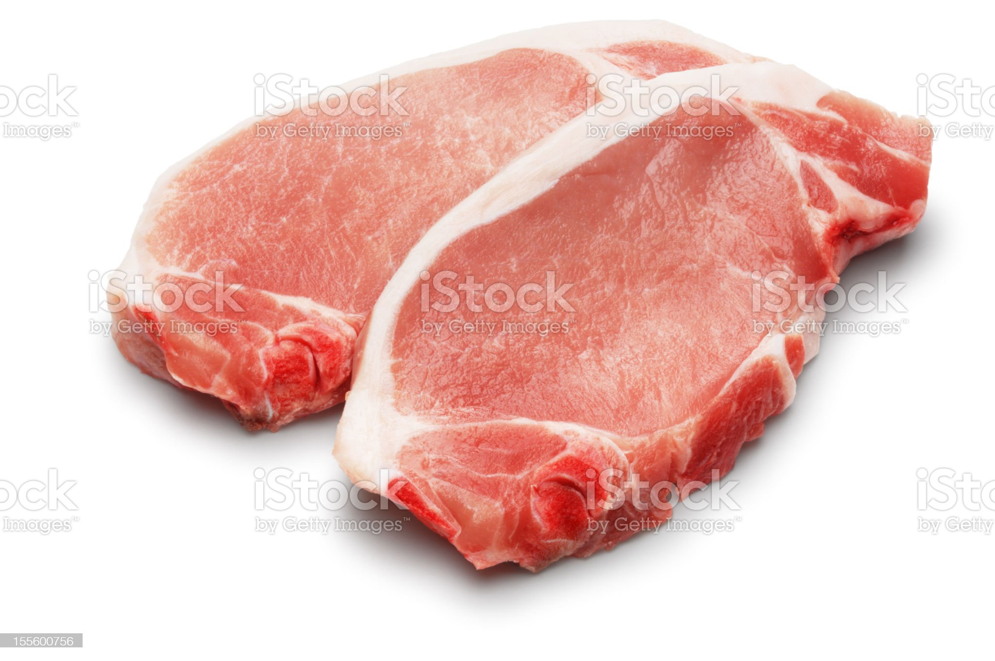 Two pork chops on white background royalty-free stock photo