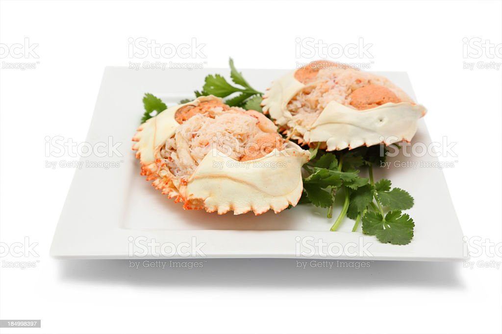 two portions dressed crab on shell isolated white square plate royalty-free stock photo