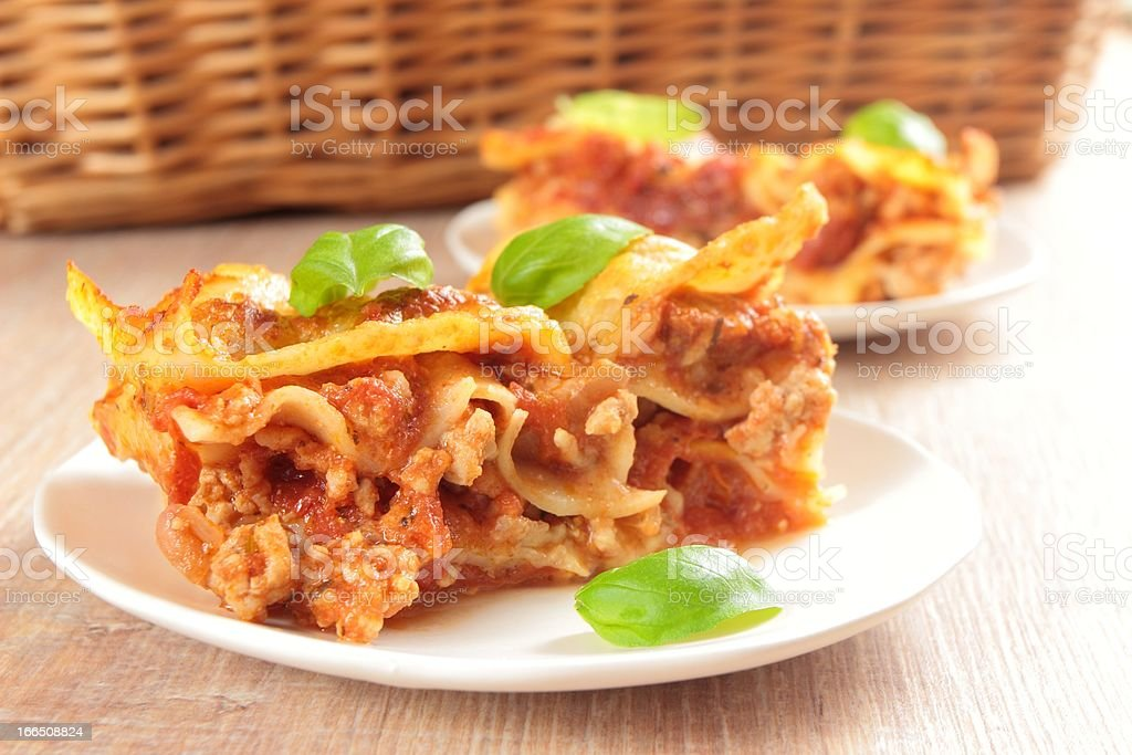 two portions of lasagne royalty-free stock photo