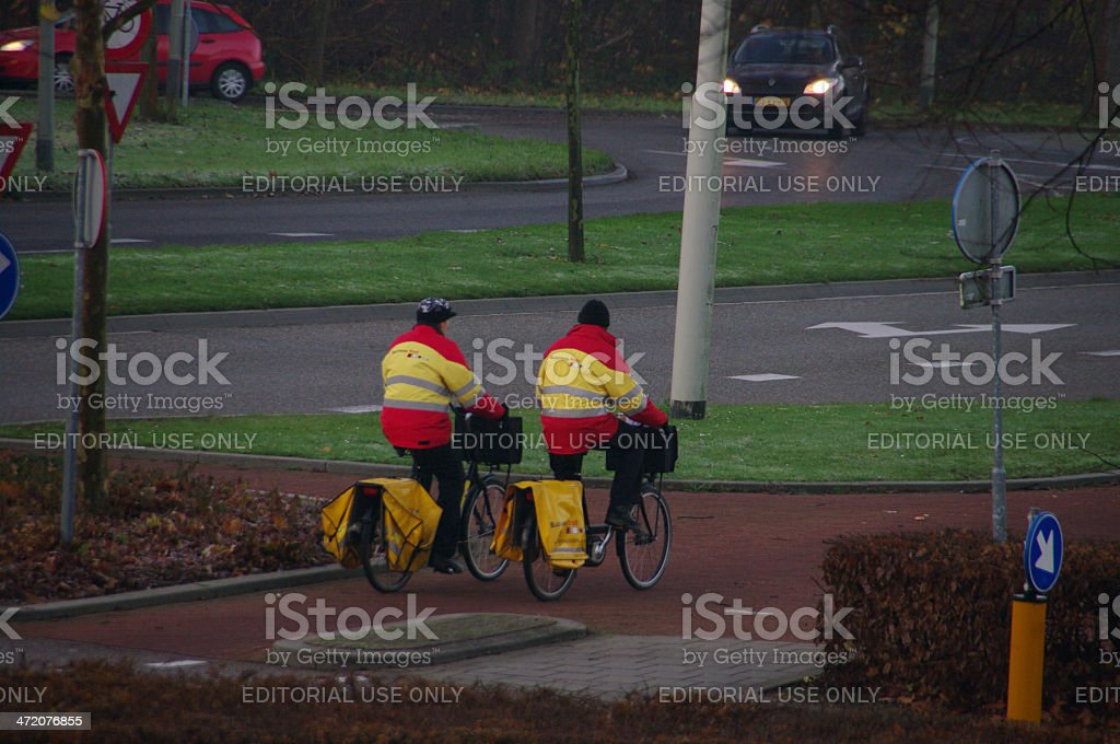Two postman on there bicycle stock photo