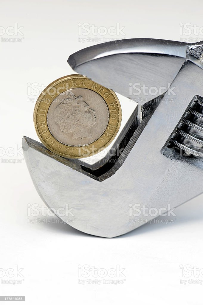 Two pound coin in wrench stock photo