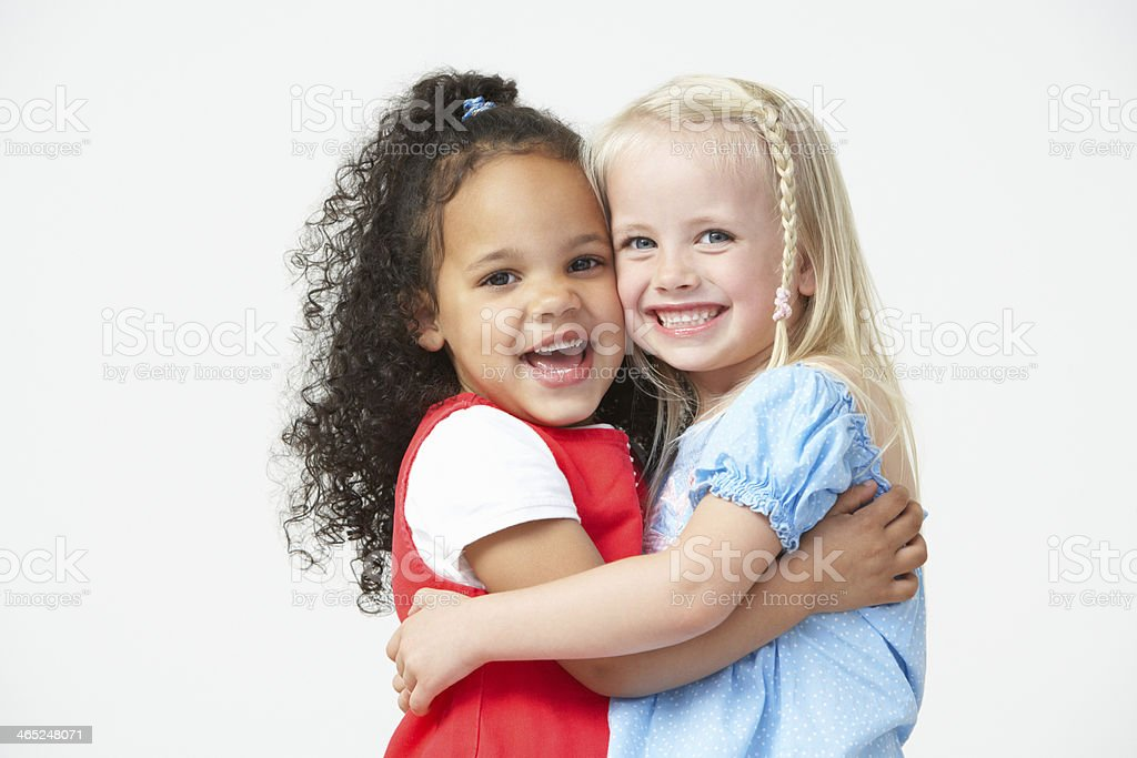 Two Pre School Girls Hugging One Another stock photo