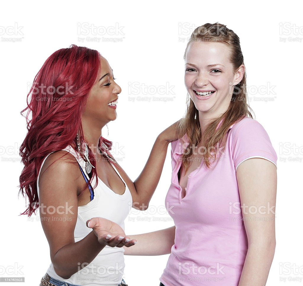 Two pretty girlfriends laugh and chat together: best friends forever! royalty-free stock photo