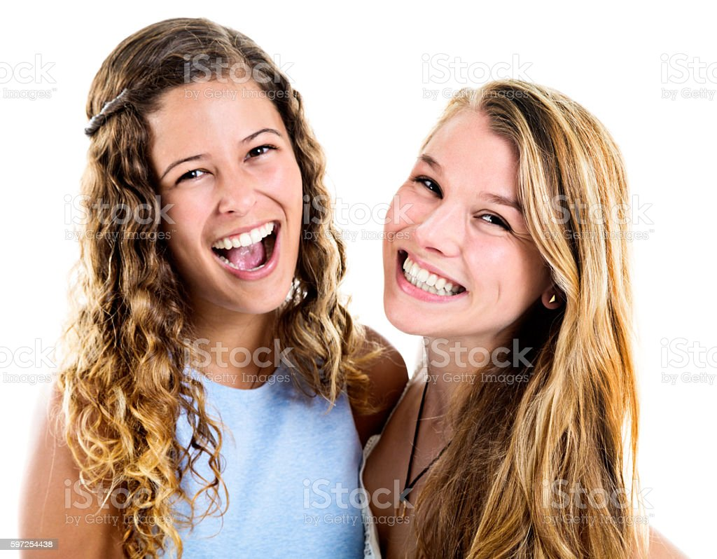 Two pretty teenage girls looking pretty delighted! stock photo