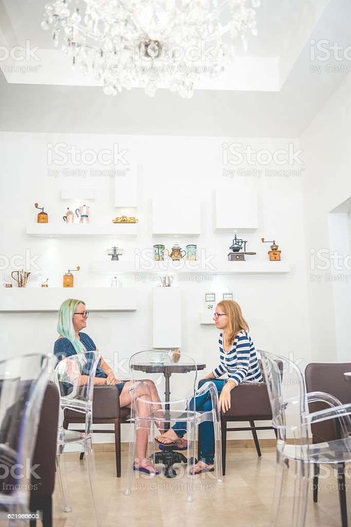 Two Pretty Women at the Coffee Bar Cafe Trieste, Europe stock photo