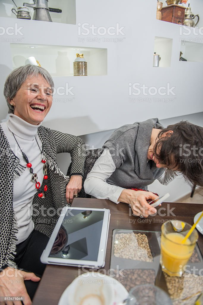 Two Pretty Women Laughing at  Caffe Trieste, Europe stock photo