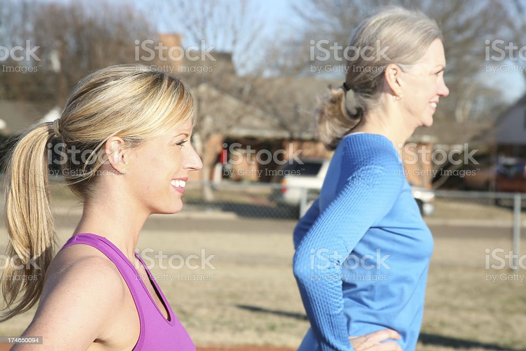 Two Pretty Women Running Together royalty-free stock photo