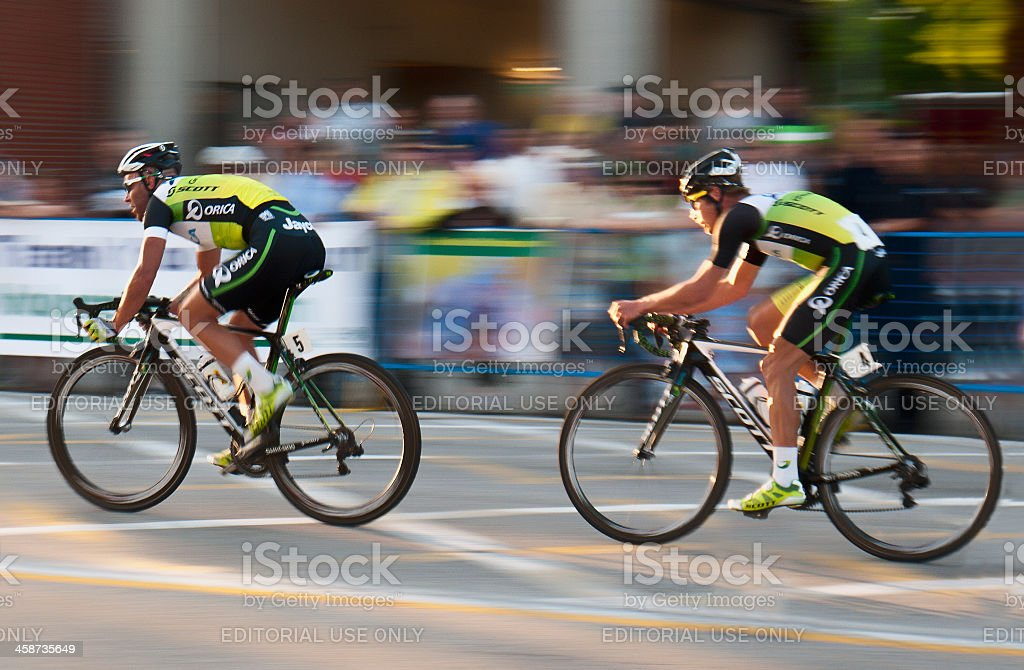 Two professional Cyclists and a blur of spectators stock photo