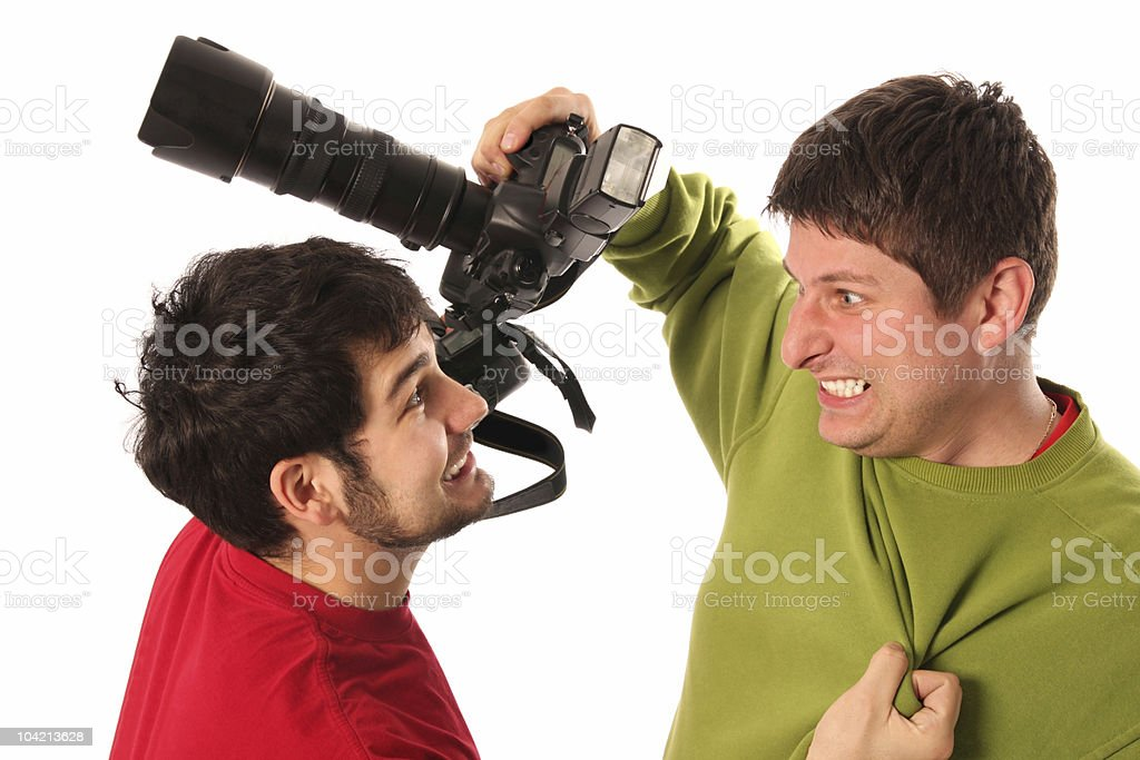 Two Professional photographers fighting royalty-free stock photo