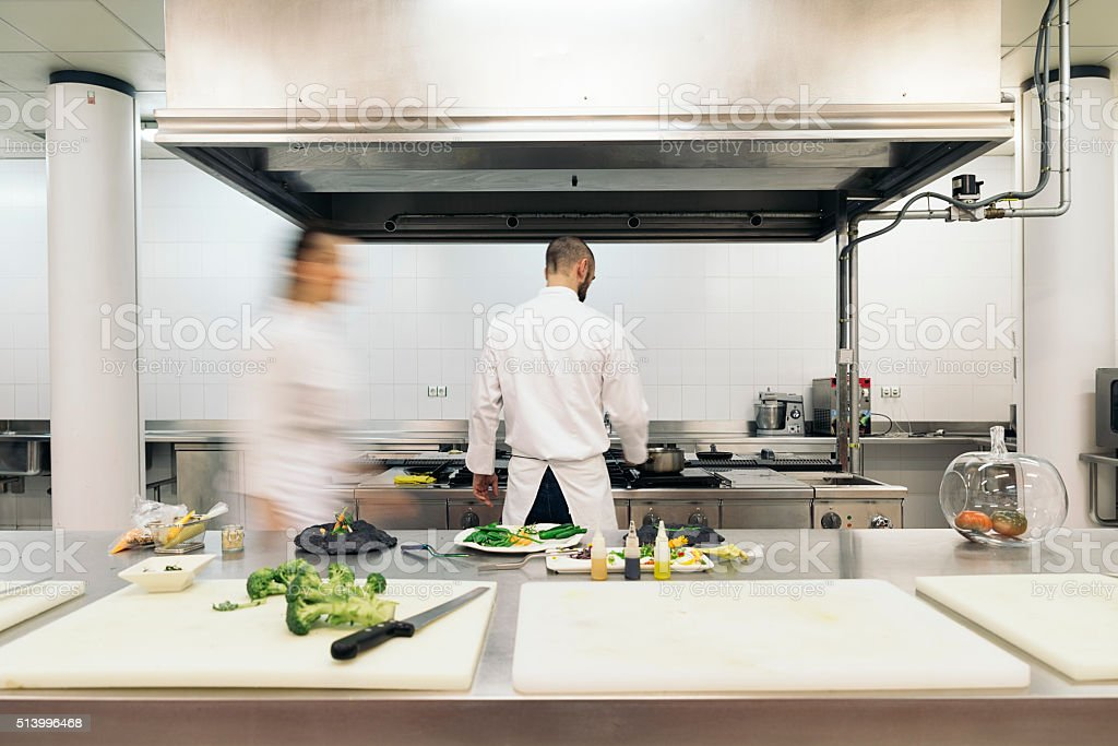Two professionals chefs cooking together. stock photo