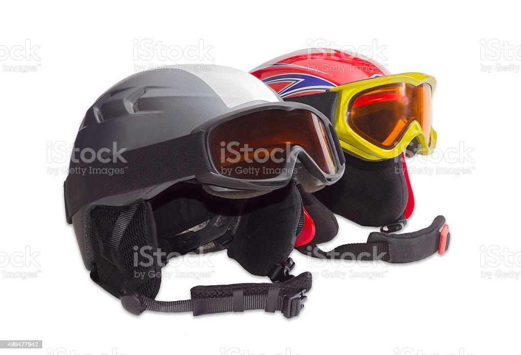 Two protective ski helmet and ski goggles stock photo