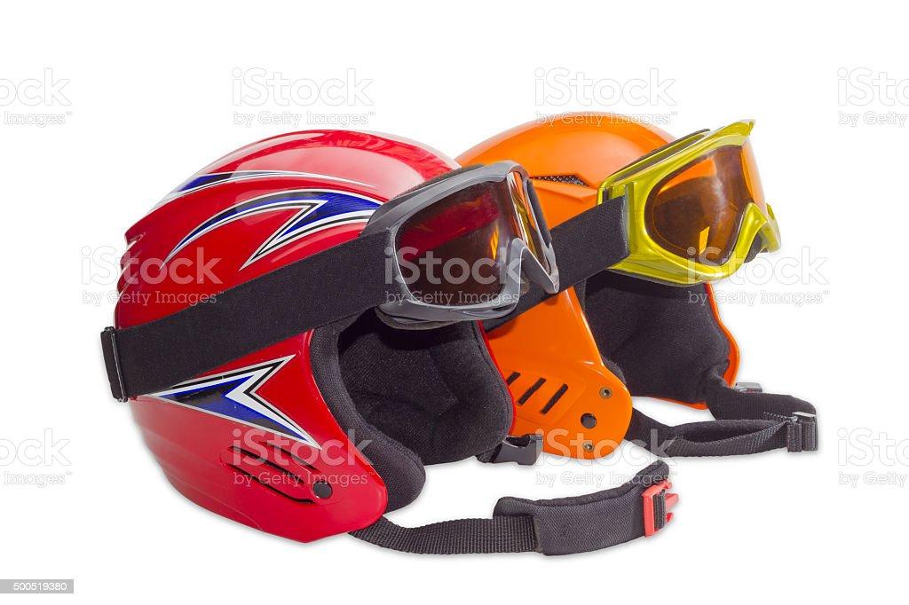 Two protective ski helmets and ski goggles stock photo
