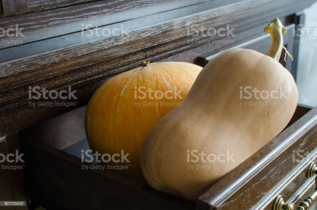 Two pumpkins - round and butternut stock photo