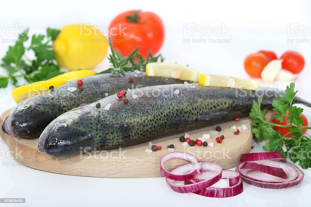 Two rainbow trouts on a board stock photo
