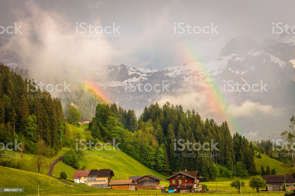 Two Rainbows in the Obersimmental, Switzerland stock photo