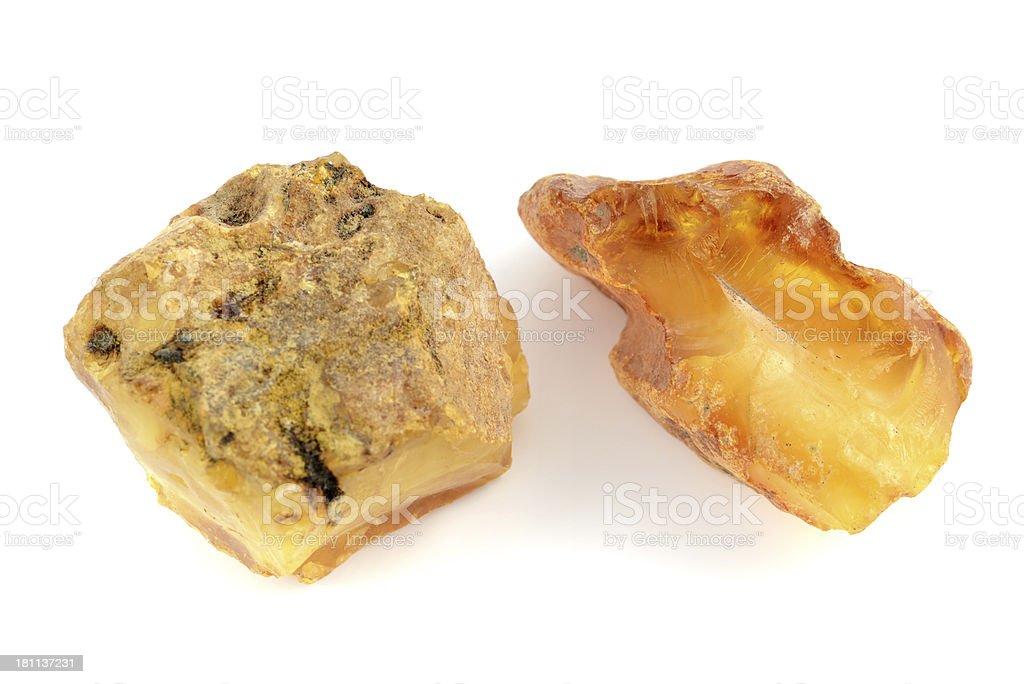 two raw amber stones on white background royalty-free stock photo