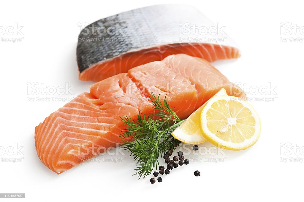 Two raw salmon fillets with fresh lemon slices stock photo