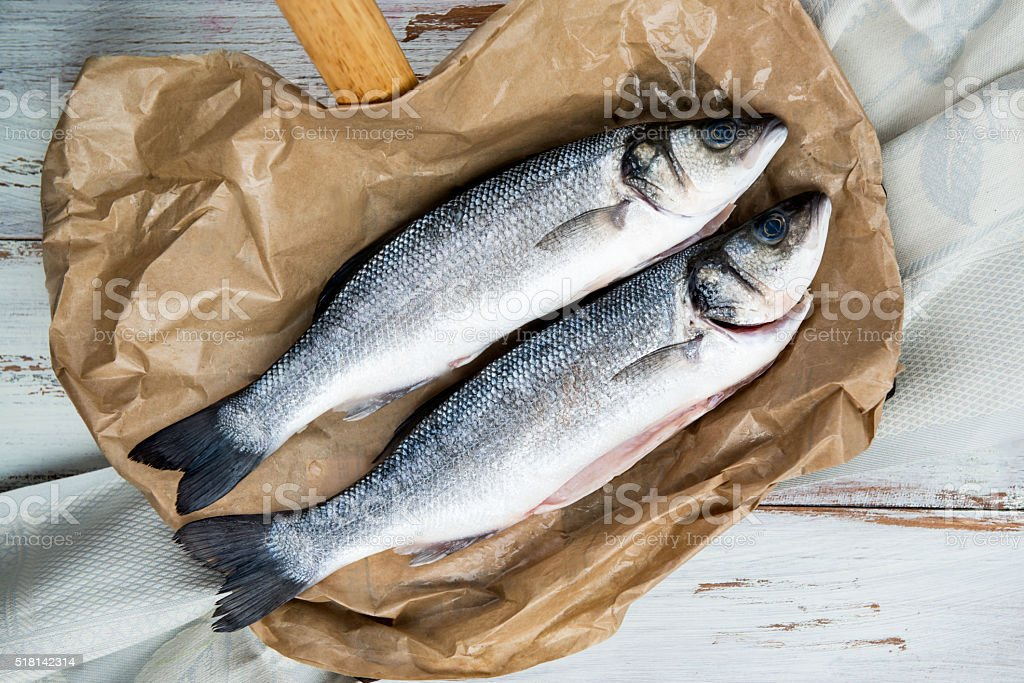 Two Raw Sea Basses stock photo