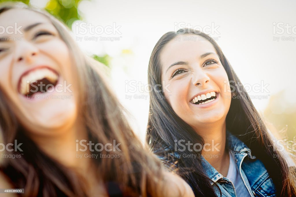Two real laughing girlfriends stock photo