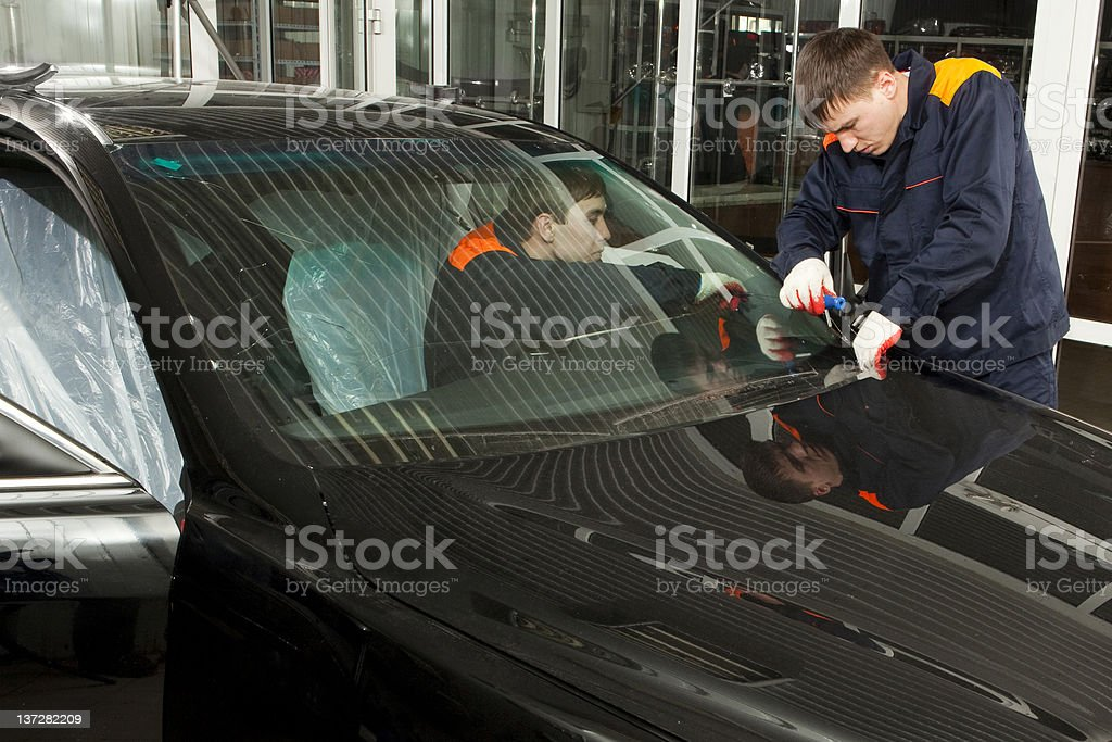 Two Real Mechanics working  in Auto Repair Shop. royalty-free stock photo