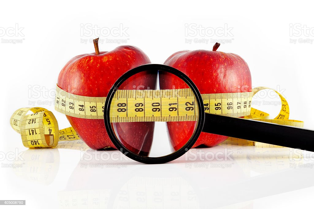 two red apple meter and magnifying glass stock photo
