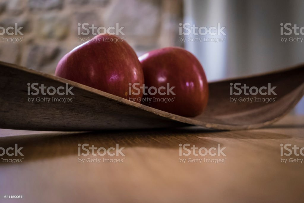 Two red apples on a decoration table stock photo