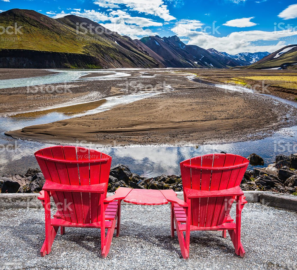 Two red chaise lounges for tourists stock photo