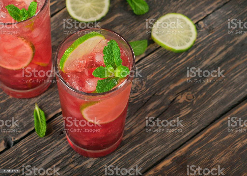 Two red cocktail with ice, lime and mint stock photo