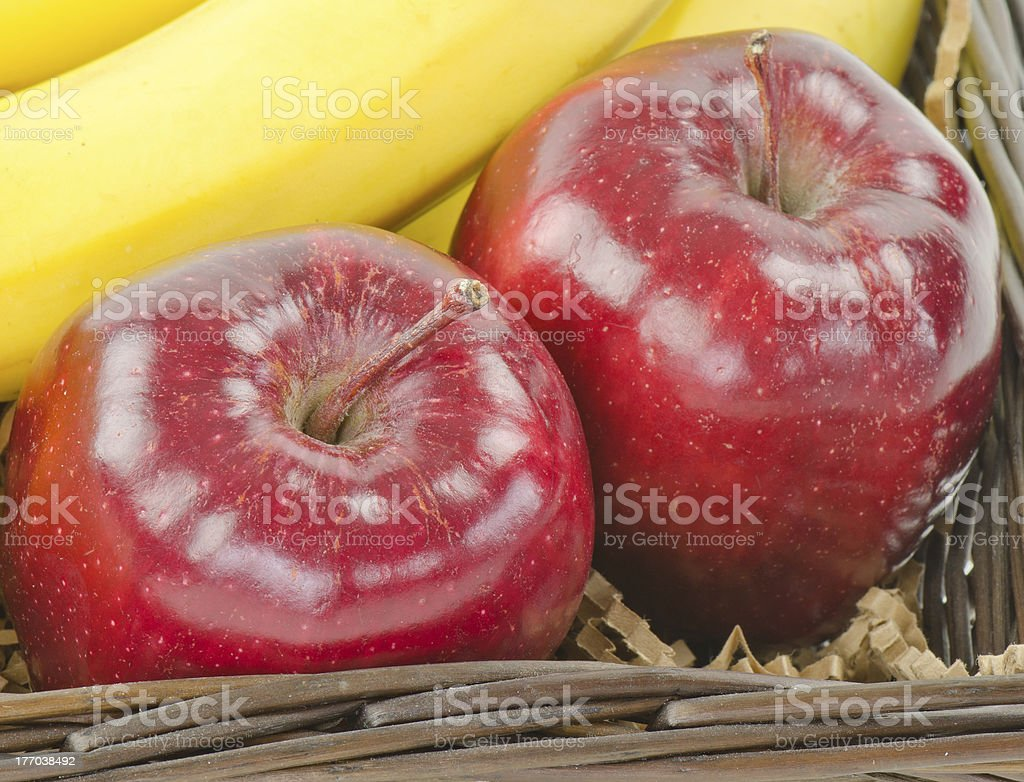 Two Red Delicious apples and a banana royalty-free stock photo