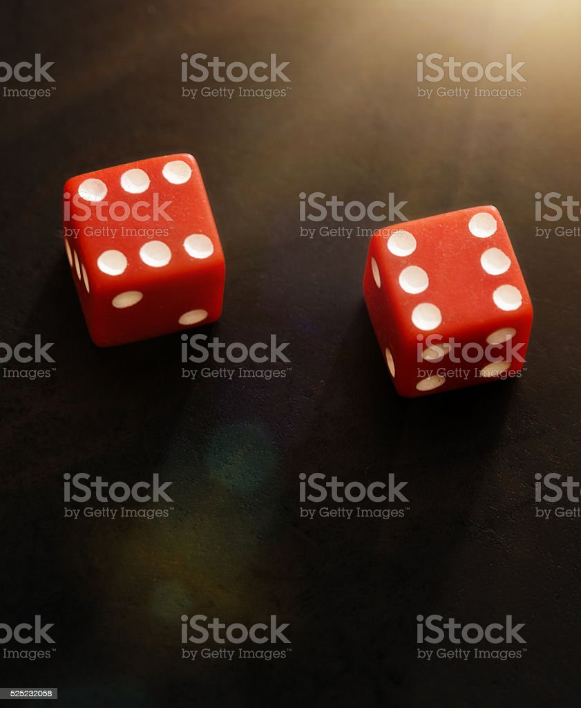 Two red dice showing score of 12 on black background stock photo