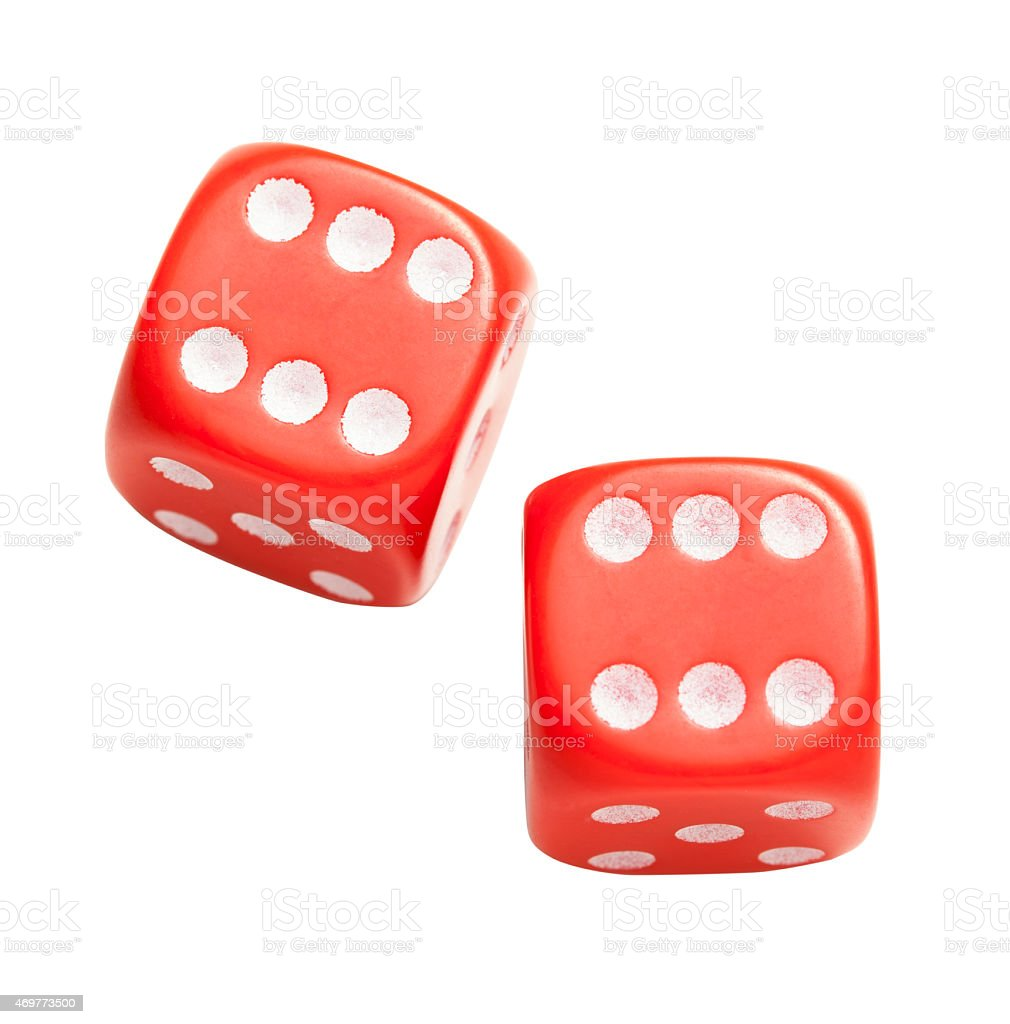 Two red dices both suspiciously showing the number six stock photo