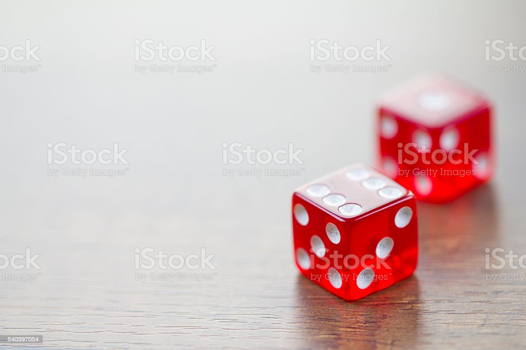 Two Red Dices Isolated on Desktop with Upper Left Space stock photo
