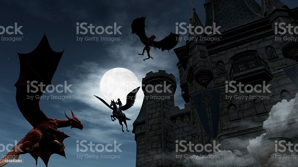 Two Red Dragons attacking the castle at night stock photo