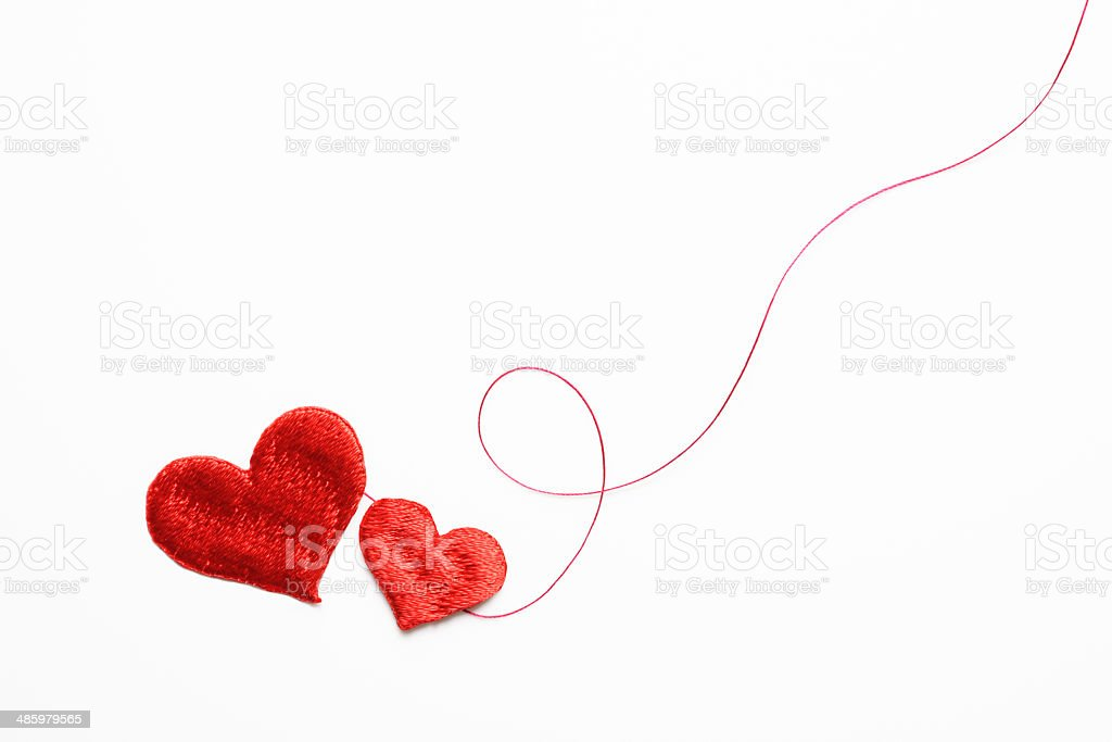 Two red heart shape embroidery with red thread on white stock photo