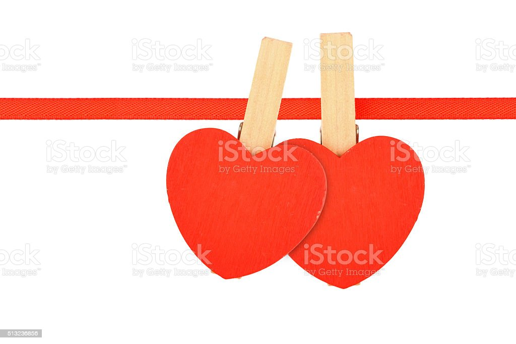 Two red hearts at ribbon isolated on white royalty-free stock photo