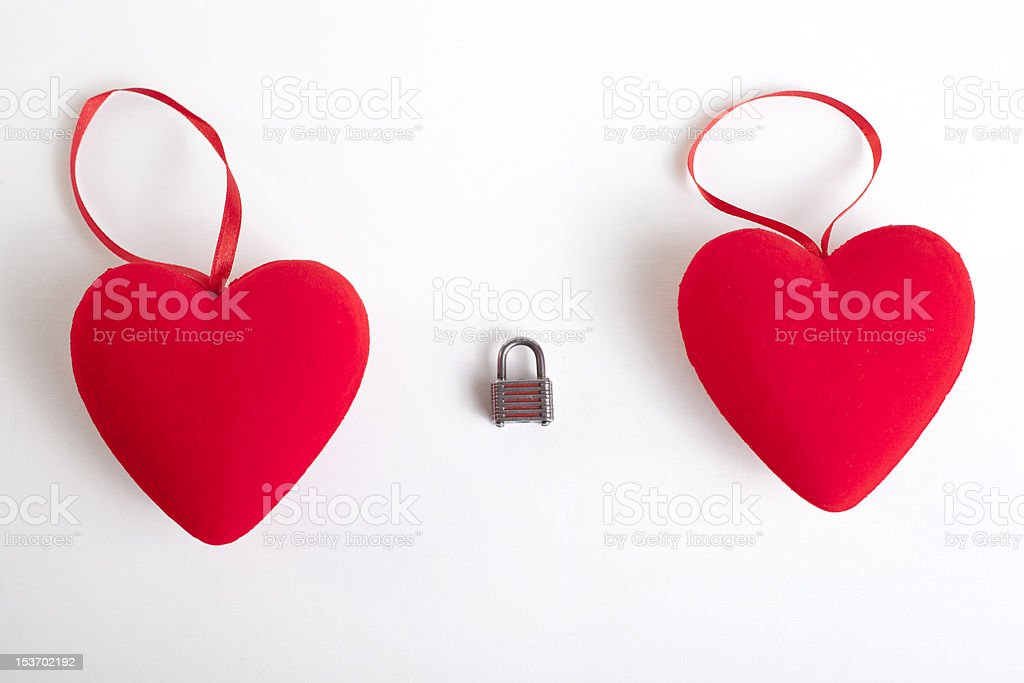 Two red hearts with padlock between them royalty-free stock photo